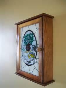 vintage wooden spice rack with glass door by vintagegeneration