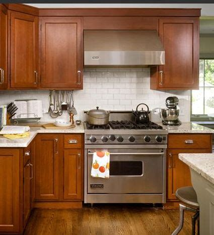 kitchen backsplash cherry cabinets 17 best images about subway tile cherry cabinets subway tile backsplash wood cabinets and