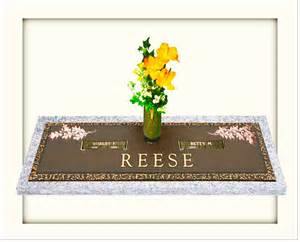 companion bronze grave markers and bronze plaques with