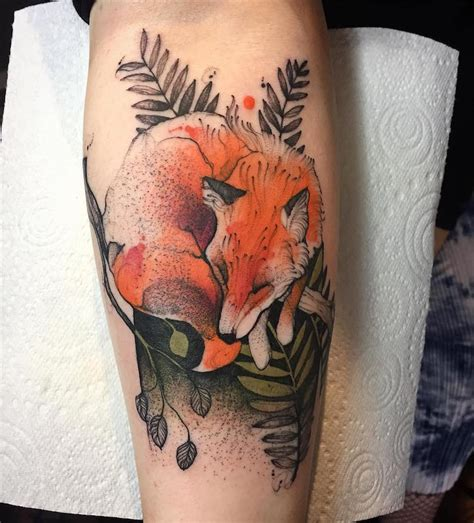 animal tattoos add bright pops of color to sketch like