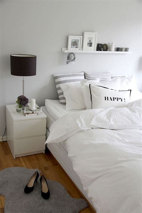 white fluffy bedroom rugs striped pillows fluffy comforter gray sheepskin rug