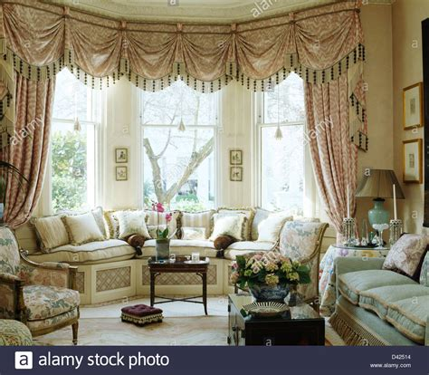 curtains for window seat swagged tailed silk curtains on bay window above window