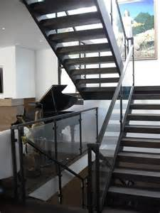 home design story stairs 3 story steel glass wood contemporary staircase san diego by skyhook stairs and rails