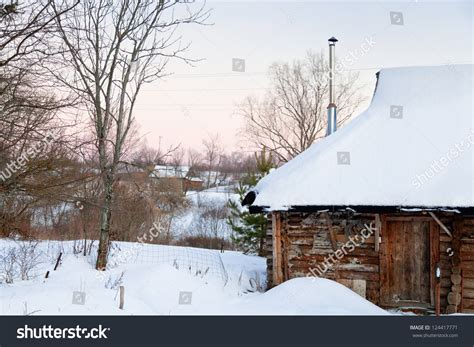 wooden russian house in winter covered with snow stock snowcovered wooden house country pink winter stock photo