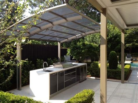 a cantaport shade structure used to protect an outdoor bbq