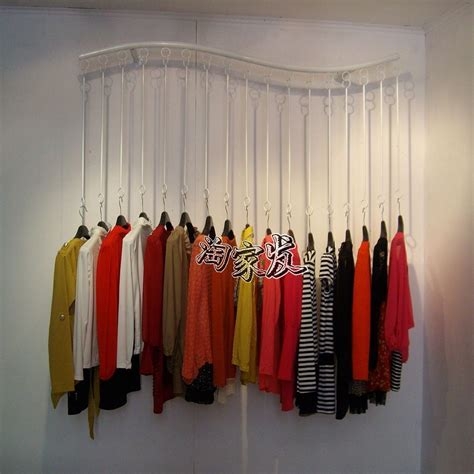 wall hangers for clothes clothing store clothing rack clothing display window