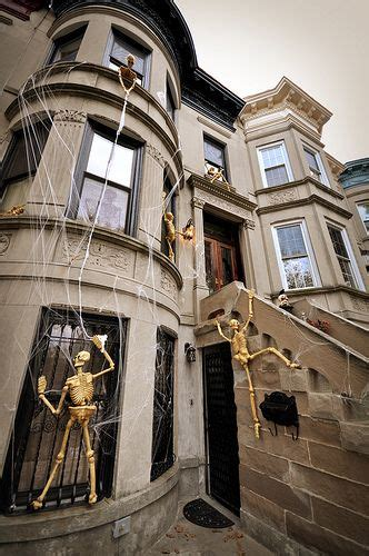 skeletons climbing house skeletons climbing the house i m not big on the macabre side of halloween but this