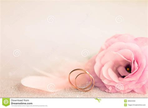 Wedding Ring Background Designs by Wedding Background With Gold Rings Gentle Flower And
