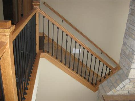 rod iron banister custom wood railings custom railings newels balusters mn minnesota finish