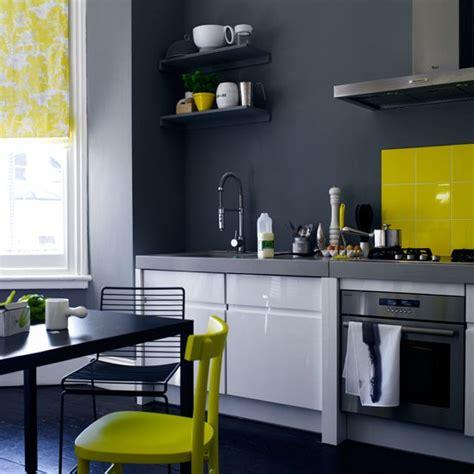 yellow kitchen splashback charcoal grey kitchen with white gloss units and yellow