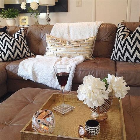 brown couch white pillows white throw blanket trays and brown leather on pinterest