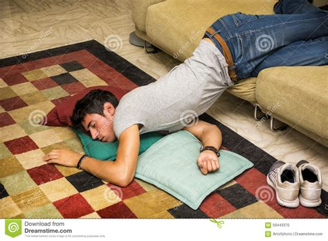 Sleeping On The Floor Without A Pillow by Resting On With On The Floor Stock