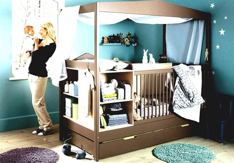 blue wall paint decoration brown crib with canopy wooden laminate flooring windows curtain boys