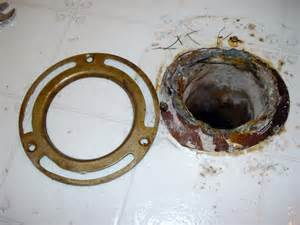 can i use silicone around a toilet flange when installing