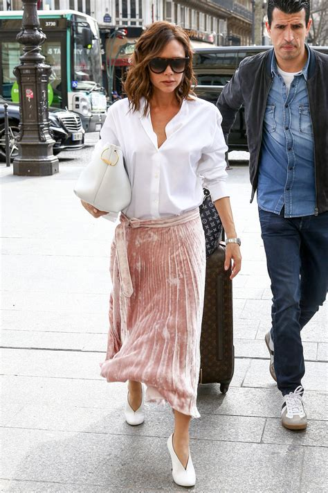 Home Decor On A Budget Blog by Victoria Beckham S Pink Pleated Skirt And White Blouse