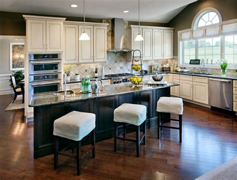 toll brothers kitchen cabinets light cabinets dark island and light colored stools for