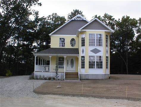 modular home modular home wrap around porch two story home with victorian details and large wrap