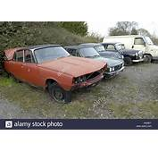 Scrap Classic Cars Parked And Having Parts Picked Off Them