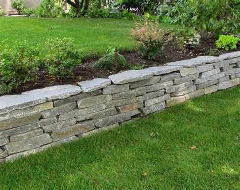 backyard retaining wall retaining walls wall installation and sloped backyard on pinterest