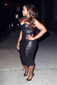 She was wearing leather clingy dress leather dress