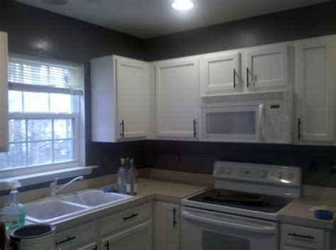 Gray Paint For Kitchen Walls | dark gray kitchen walls with white cabinets during