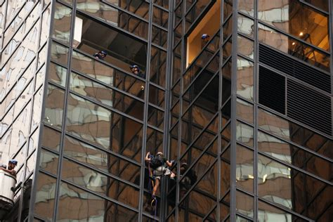 man is trying to scale trump tower on fifth avenue in nyc man attempts to scale trump tower in n y c using suction