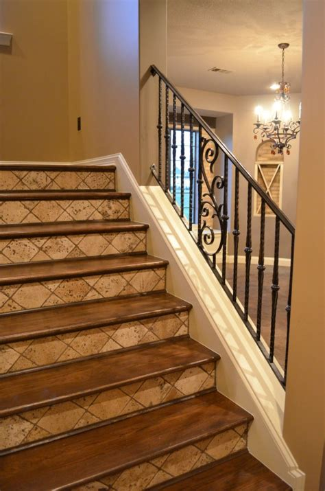 pictures of wood stairs iron railing tumbled tile risers and stained wood treads