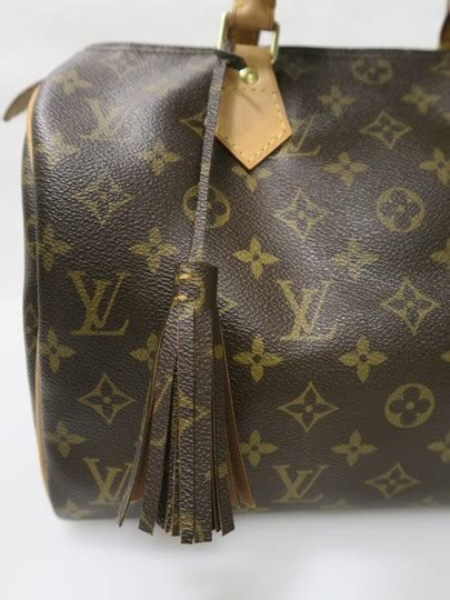 louis vuitton monogram medium tassel bag charm tradesy