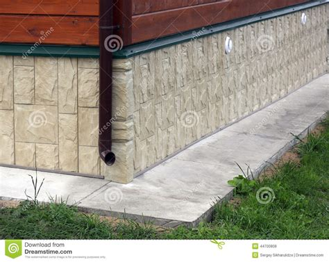 Cottage Foundation by Cottage Foundation Faced By Artificial Stock Photo