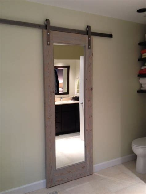 mirrored bathroom door sliding bathroom door gray toned antique wood doors