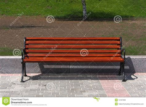 city park bench new wooden bench in a city park stock photos image 14197393
