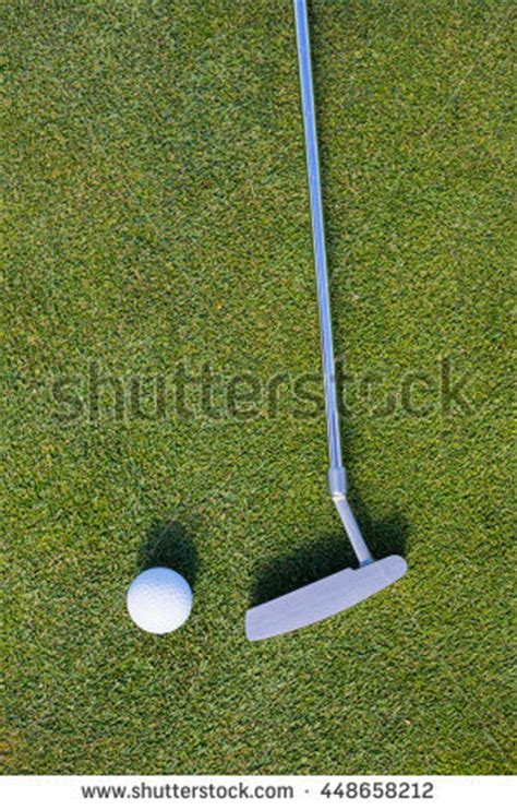 overhead view of golf swing white golf ball near hole on stock photo 1271001