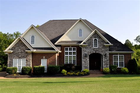 Home Exterior Design Brick And Stone by Brick Stone And Dryvit Exterior In Traditional Colors