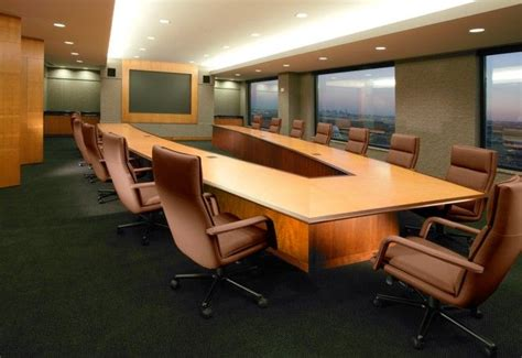 V shaped conference table with cantilevered top and