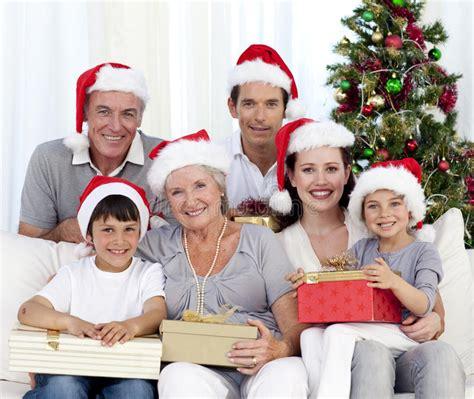 happy family holding christmas presents stock photo
