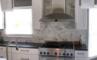 marble subway tile backsplash kitchen orangerie and blue renovation progress