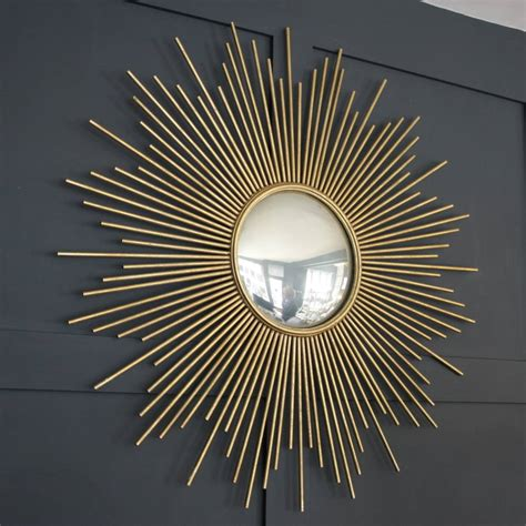 large gold sunburst wall mirror by ella