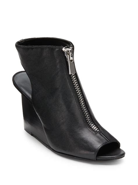 nine west hollyroot peep toe wedge ankle boots in black lyst