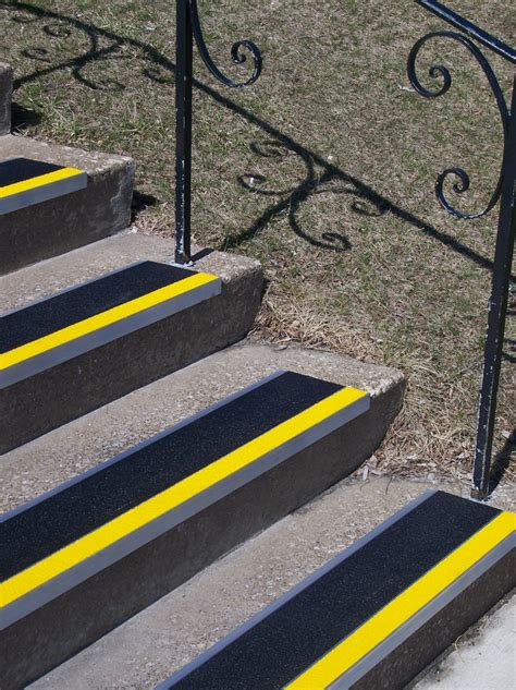 Stair Tread Safety Strips by Stairway Visibility Through Contrasting Colored Step Nosing