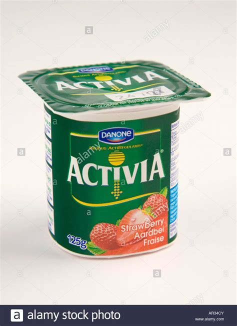 8 Uses For Yoghurt Pots by Pot Of Strawberry Flavoured Danone Activia Yoghurt Stock