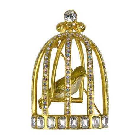 Karl Lagerfeld Gold karl lagerfeld gold gilt caged bird brooch at 1stdibs