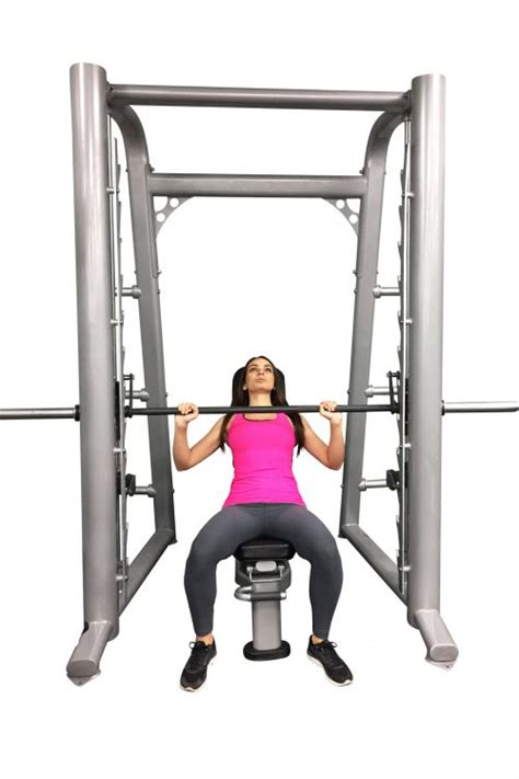 chest press machine vs bench press smith machine bench press vs barbell bench press