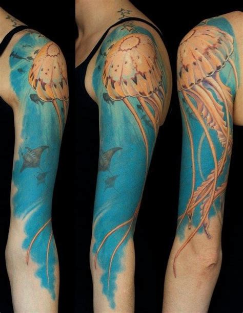 nice jellyfish in ocean tattoo on full sleeve