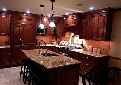 cherry kitchen cabinets with granite countertops creating a stylish kitchen look using kitchen pain colors