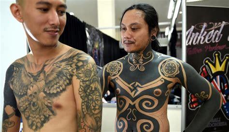 tato leak bali di dada para pencinta tato berkumpul di bali tattoo expo 2017