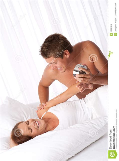 fun in bed young couple having fun in white bed stock photos image