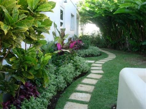 landscaping ideas for the side of the house the villa garden renos tropical landscape other metro by home and garden spaces