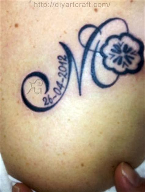 m and m tattoo monogram m four leaf clover tattoos on the