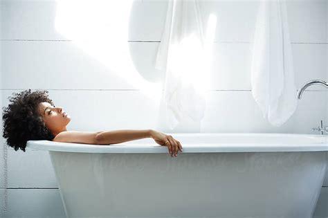 woman in bathtub african american woman relaxing in bathtub by trinette