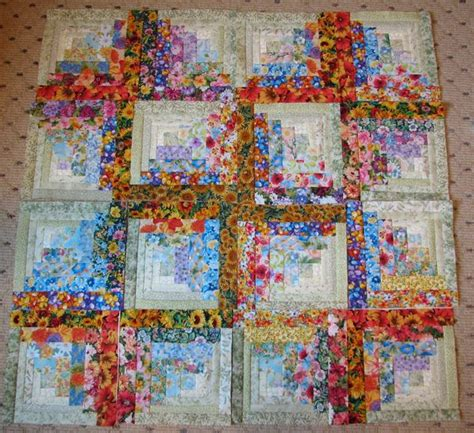 12 new watercolor floral log cabin squares done and some